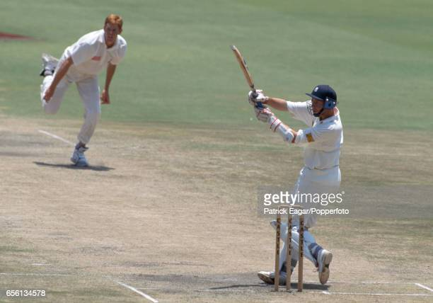Mike Atherton of England hooks a delivery from South Africa bowler Shaun Pollock during his innings of 185 not out in the 2nd Test match between...
