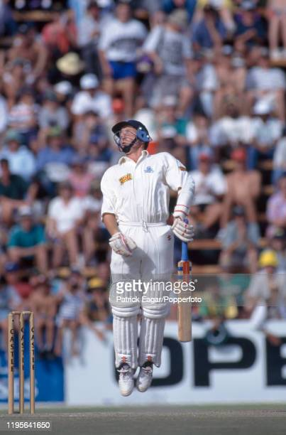 Mike Atherton of England tries to avoid a bouncer during his innings of 185 not out in the 2nd Test match between South Africa and England at the New...