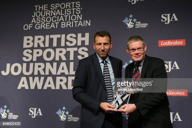 Mike Atherton of The Times is presented with Cricket Journalist of the Year Award by Philip Barker during the SJA British Sports Journalism Awards at...