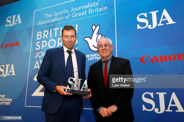 Mike Atherton The Times is presented with the Cricket journalist award by Colin Bateman during the SJA British Sports Journalism Awards 2019 at Park...