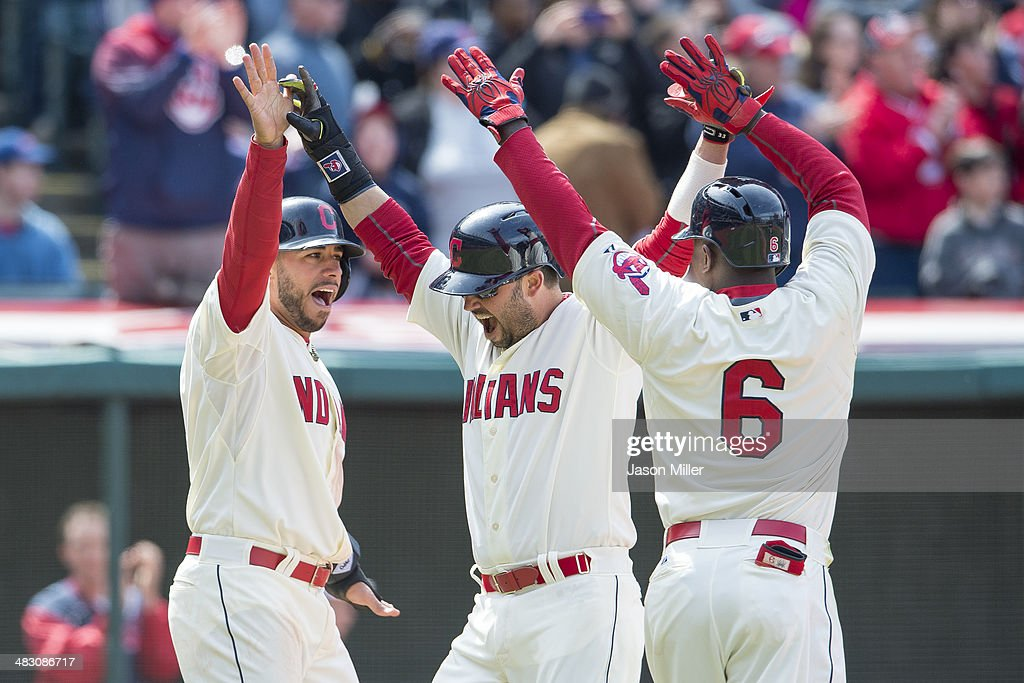 Mike Aviles #4 Nick Swisher #33 and Nyjer Morgan #6 celebrate after scoring on a double by Jason Kipnis #22 of the Cleveland Indians during the fourth inning against the Minnesota Twins at Progressive Field on April 6, 2014 in Cleveland, Ohio.