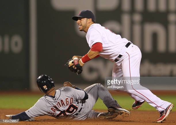 Mike Aviles of the Boston Red Sox is unable to turn the double play as Ramon Santiago of the Detroit Tigers slides into second in the fifth inning at...
