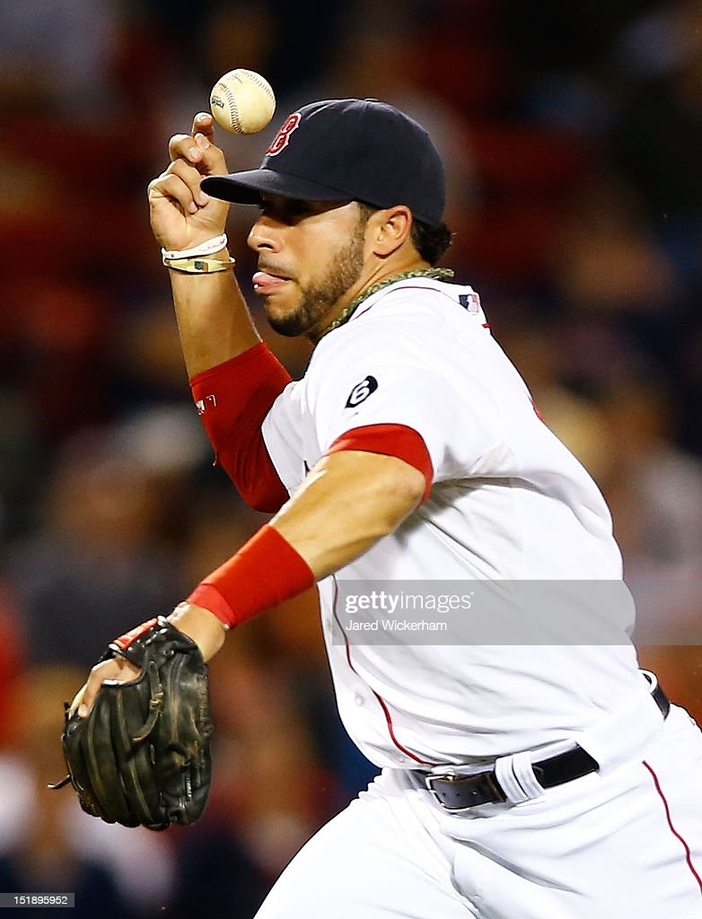 Mike Aviles #3 of the Boston Red Sox misplays a throw to first base against the New York Yankees during the game on September 12, 2012 at Fenway Park in Boston, Massachusetts.