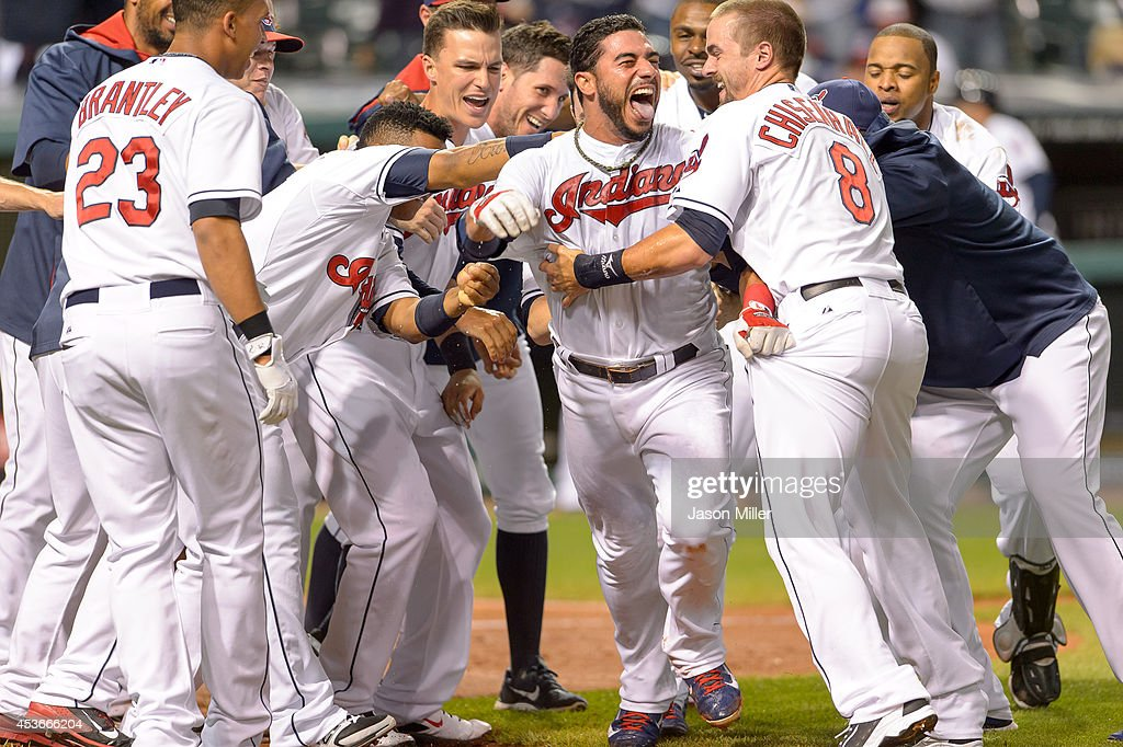 Mike Aviles #4 of the Cleveland Indians celebrates with teammates after hitting a walk-off solo home run during the eleventh inning against the Baltimore Orioles at Progressive Field on August 15, 2014 in Cleveland, Ohio. The Indians defeated the Orioles 2-1 in 11 innings.