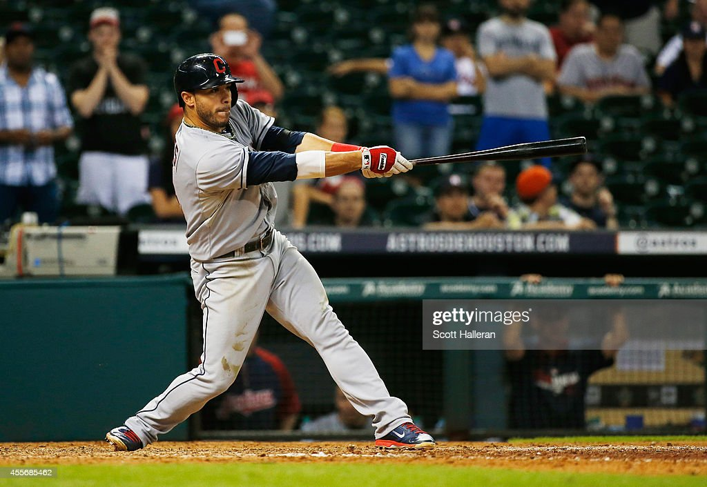 Mike Aviles #4 of the Cleveland Indians drives in a run in the 13th inning against the Houston Astros during their game at Minute Maid Park on September 18, 2014 in Houston, Texas.