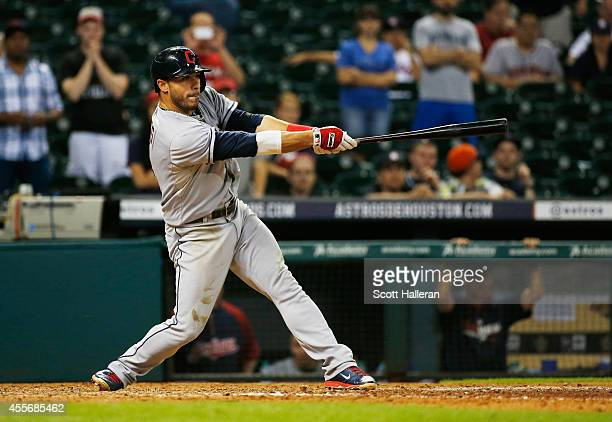 Mike Aviles of the Cleveland Indians drives in a run in the 13th inning against the Houston Astros during their game at Minute Maid Park on September...