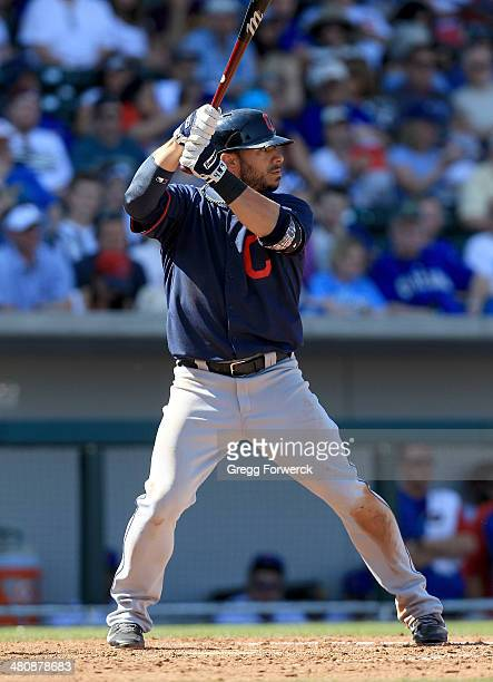 Mike Aviles of the Cleveland Indians hits during a spring training baseball game against the Cleveland Indians at Cubs Park on March 7 2014 in Mesa...