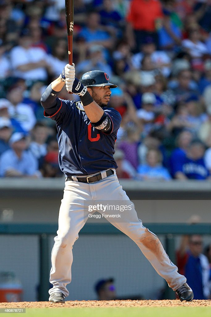 Mike Aviles #4 of the Cleveland Indians hits during a spring training baseball game against the Cleveland Indians at Cubs Park on March 7, 2014 in Mesa, Arizona.