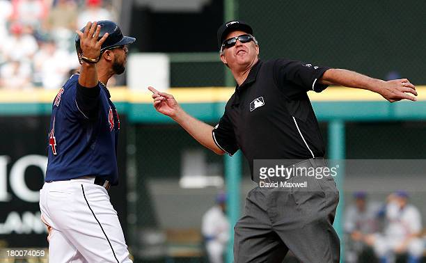 Mike Aviles of the Cleveland Indians is ejected from the game by second base umpire Gary Darling during an argument after he was called out stealing...