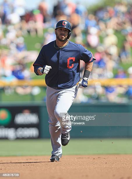 Mike Aviles of the Cleveland Indians runs the bases during a spring training baseball game against the Chicago Cubs at Cubs Park on March 7 2014 in...