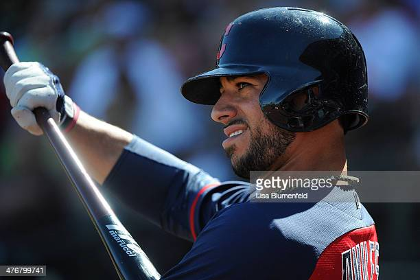 Mike Aviles of the Cleveland Indians waits on deck during the game against the Texas Rangers at Surprise Stadium on March 3 2014 in Surprise Arizona