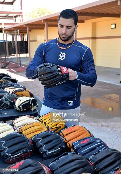 Mike Aviles of the Detroit Tigers tries on a new Rawlings baseball glove after the Spring Training workout day at Joker Marchant Stadium on February...