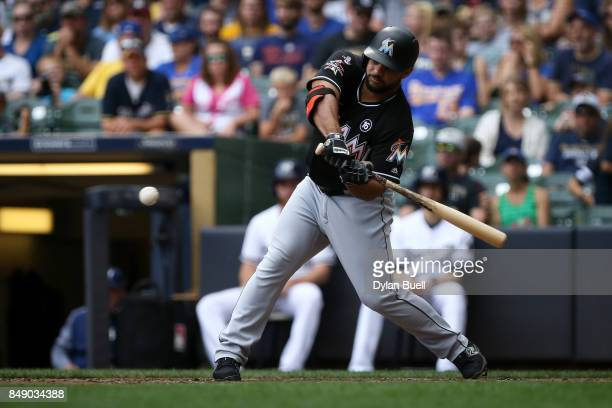 Mike Aviles of the Miami Marlins hits a single in the seventh inning against the Milwaukee Brewers at Miller Park on September 17 2017 in Milwaukee...