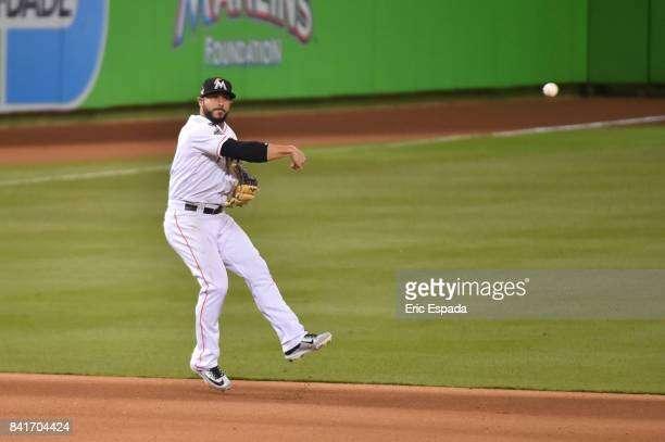 Mike Aviles of the Miami Marlins throws towards second base during the seventh inning against the Philadelphia Phillies at Marlins Park on September...