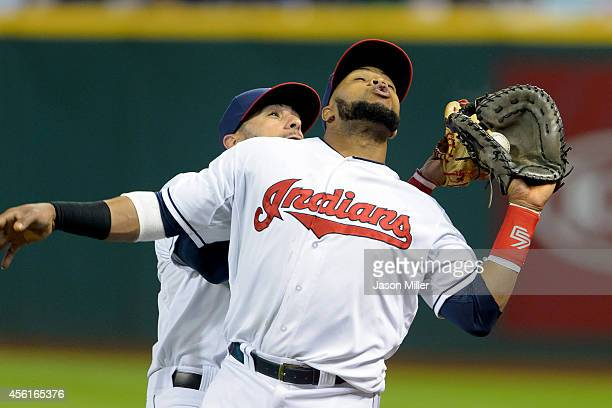 Mike Aviles runs into Carlos Santana of the Cleveland Indians as Santana catches a fly ball hit by Ryan Hanigan of the Tampa Bay Rays to end the top...
