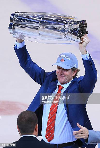 Mike Babcock Head Coach of Team Canada lifts the World Cup Trophy following Game Two of the World Cup of Hockey final series against Team Europe at...