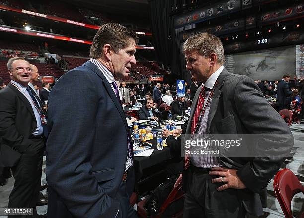 Mike Babcock head coach of the Detroit Red Wings talks with Bill Peters head coach of the Carolina Hurricanes on Day Two of the 2014 NHL Draft at the...