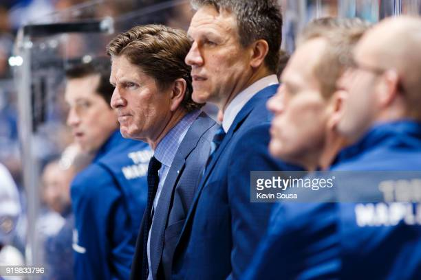 Mike Babcock head coach of the Toronto Maple Leafs looks on from the bench at an NHL game against the Columbus Blue Jackets during the second period...