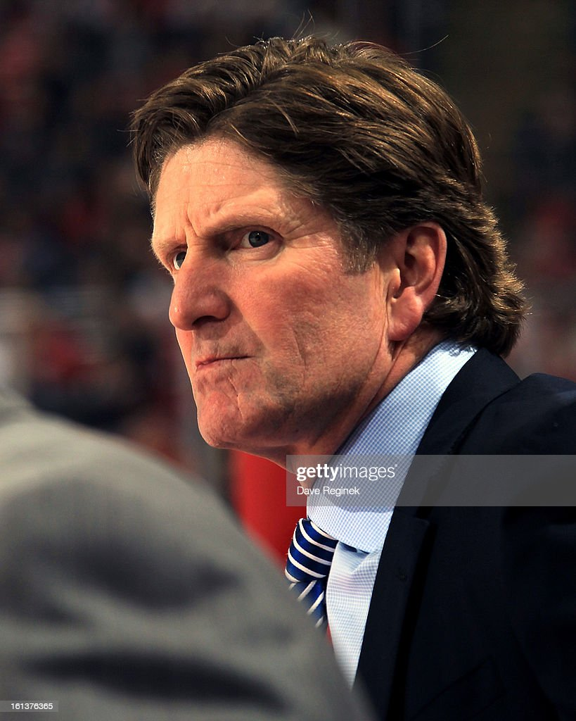 Mike Babcock of the Detroit Red Wings looks on from the bench for the 750th time as a NHL Head Coach during a game against the Los Angeles Kings at Joe Louis Arena on February 10, 2013 in Detroit, Michigan. Detroit defeated Loas Angeles 3-2