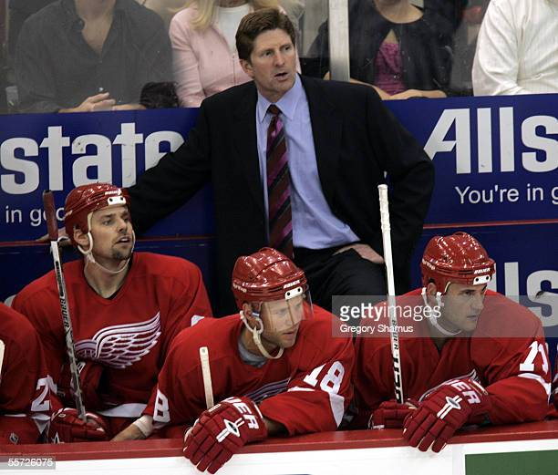 Mike Babcock the new head coach of the Detroit Red Wings looks on from behind the bench during a preseason NHL game against the Tampa Bay Lightning...