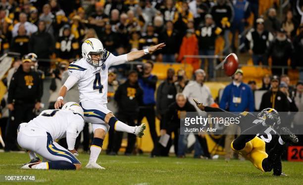 Mike Badgley of the Los Angeles Chargers kicks the game winning field goal with no time left on the clock in the fourth quarter during the game...