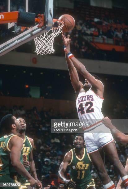 Mike Bantom of the Philadelphia 76ers goes in for a layup against the Utah Jazz during an NBA basketball game circa 1982 at The Spectrum in...