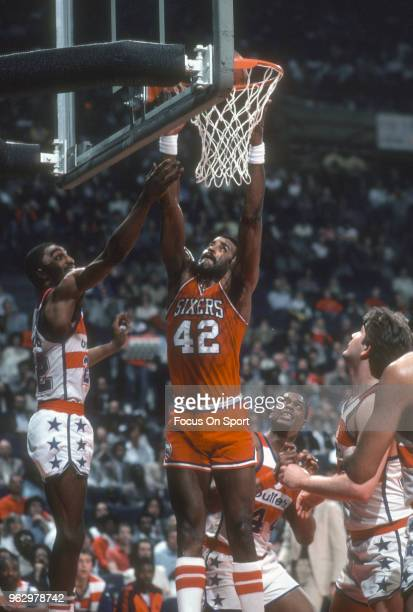 Mike Bantom of the Philadelphia 76ers goes up for a slam dunk against the Washington Bullets during an NBA basketball game circa 1982 at the Capital...