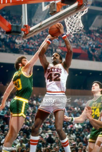 Mike Bantom of the Philadelphia 76ers shoots over Ben Poquette of the Utah Jazz during an NBA basketball game circa 1982 at The Spectrum in...