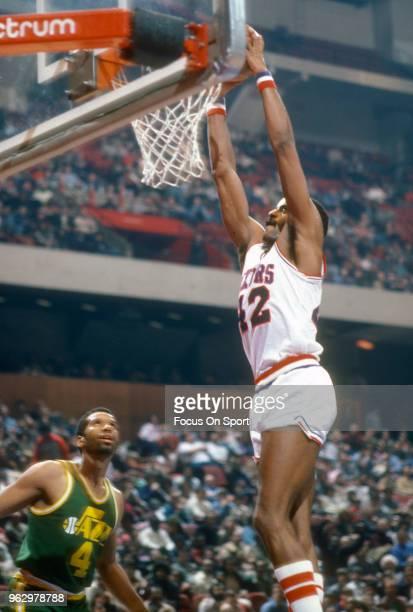 Mike Bantom of the Philadelphia 76ers slam dunks against the Utah Jazz during an NBA basketball game circa 1982 at The Spectrum in Philadelphia...