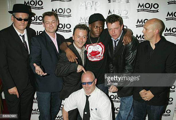 Mike Barson Chris Foreman Lee Thompson John Hasler Cathal Smyth and Suggs of Madness pose with Dizzie Rascal in the Awards Room at the MOJO Honours...