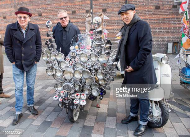 Mike Barson Graham McPherson aka Suggs and Mark Bedford of Madness with a scooter belonging to a member of the Croxley Rebels Scooter Club after...