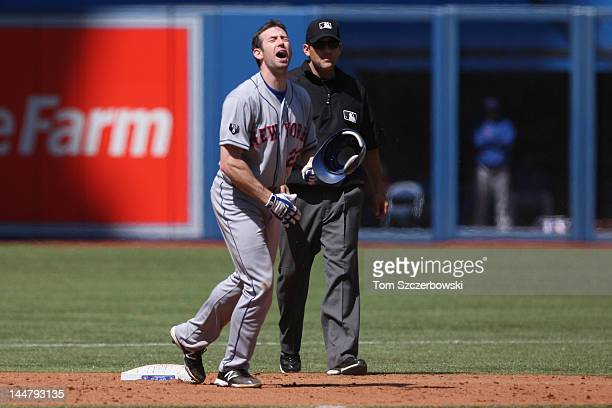 Mike Baxter of the New York Mets reacts after being called out trying to stretch a single into a double in the 9th inning by second base umpire Brian...