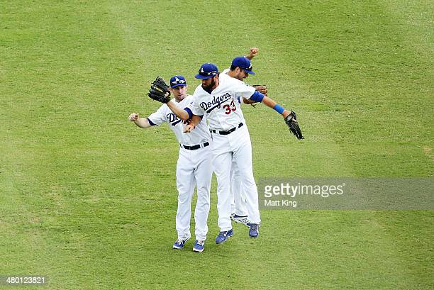 Mike Baxter Scott Van Slyk and Andre Ethier of the Dodgers celebrate winning the MLB match between the Los Angeles Dodgers and the Arizona...