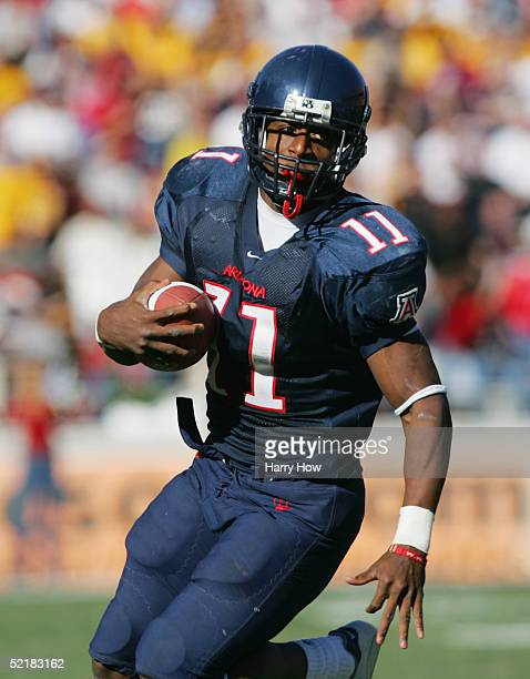 Mike Bell of the Arizona Wildcats runs the ball during the game against the Arizona State Sun Devils at Arizona Stadium on November 26 2004 in Tucson...