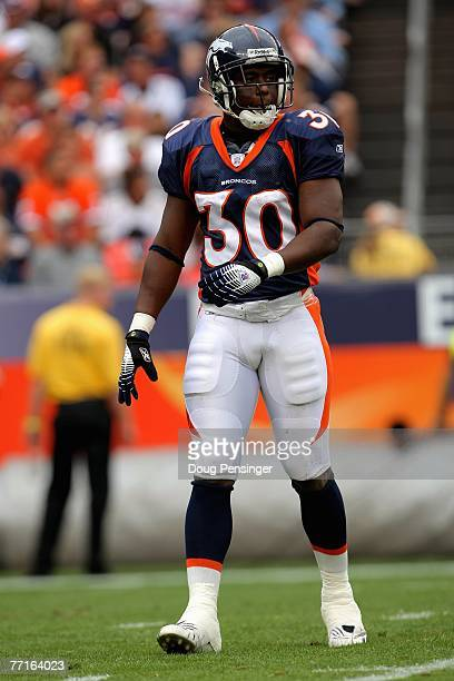 Mike Bell of the Denver Broncos looks on against the Jacksonville Jaguars at Invesco Field at Mile High on September 23 2007 in Denver Colorado The...