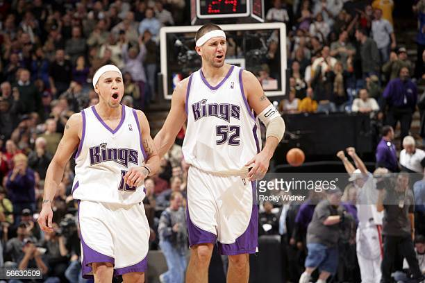 Mike Bibby and Brad Miller of the Sacramento Kings celebrate in overtime against the Los Angeles Lakers on January 19, 2006 at the ARCO Arena in...