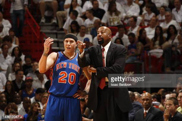Mike Bibby and Mike Woodson Head Coach of the New York Knicks disscuss a play during the game against the Miami Heat in Game One of the Eastern...