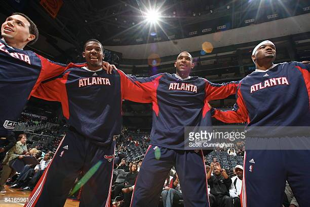 Mike Bibby Joe Johnson Al Horford and Josh Smith of the Atlanta Hawks huddle before the game against the Houston Rockets at Philips Arena on January...