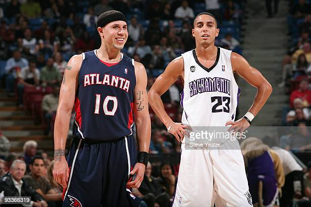 Mike Bibby of the Atlanta Hawks and Kevin Martin of the Sacramento Kings stand on the court during the game on November 4 2009 at Arco Arena in...