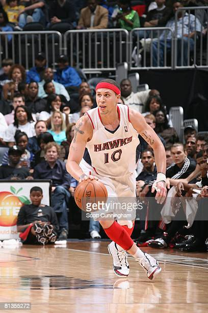 Mike Bibby of the Atlanta Hawks moves the ball against the Philadelphia 76ers during the game at Philips Arena on April 4 2008 in Atlanta Georgia The...