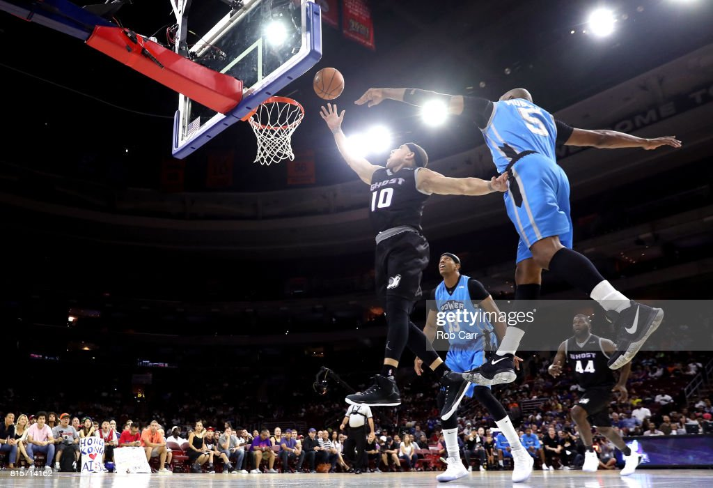 Mike Bibby #10 of the Ghost Ballers drives to the basket against Cuttino Mobley #5 of Power during week four of the BIG3 three on three basketball league at Wells Fargo Center on July 16, 2017 in Philadelphia, Pennsylvania.