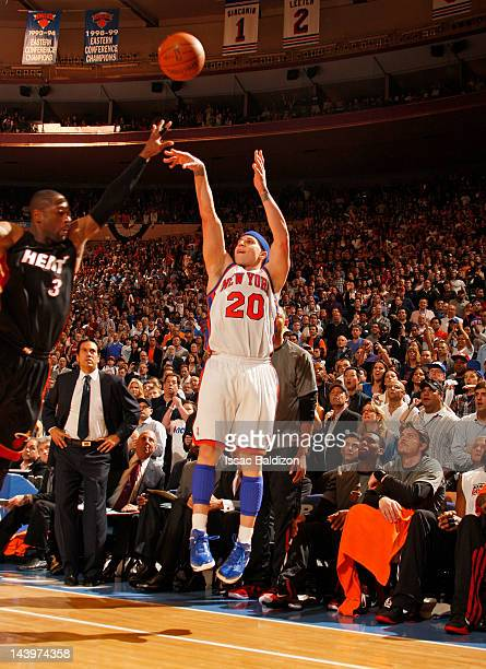 Mike Bibby of the New York Knicks shoots and makes a clutch three point shot late in the fourth quarter against Dwyane Wade of the Miami Heat in Game...