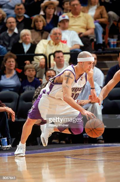 Mike Bibby of the Sacramento Kings drives during the game against the Utah Jazz at Arco Arena on February 27 2004 in Sacramento California The Jazz...