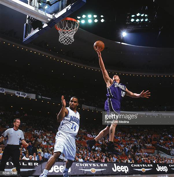 Mike Bibby of the Sacramento Kings goes up for a layup over Jameer Nelson of the Orlando Magic during a game at TD Waterhouse Centre on March 2 2005...