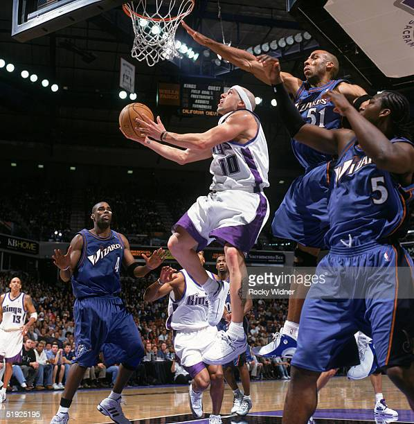 Mike Bibby of the Sacramento Kings shoots against Michael Ruffin of the Washington Wizards during the game at Arco Arena on December 21 2004 in...