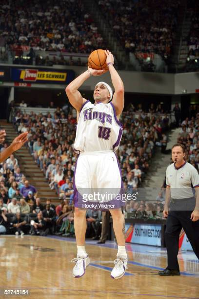 Mike Bibby of the Sacramento Kings shoots an open jumper against the Seattle SuperSonics in Game four of the Western Conference Quarterfinals during...