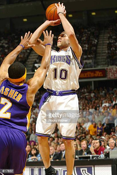 Mike Bibby of the Sacramento Kings takes the jump shot against Derek Fisher of the Los Angeles Lakers during Game 7 of the 2002 NBA Western...