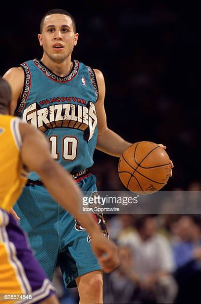Mike Bibby of the Vancouver Grizzlies dribbles the ball during a National Basketball Association game against the Los Angeles Lakers at the Staples...