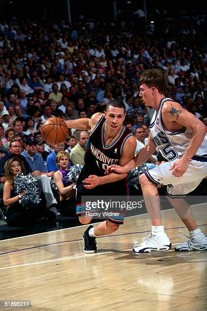 Mike Bibby of the Vancouver Grizzlies drives against the Sacramento Kings during the NBA game in Sacramento California NOTE TO USER User expressly...
