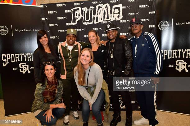 Mike Bivins Ricky Bell and Brooke Payne pose with guests at the 'PUMA Rep Your School Peace Basketball Jamboree' hosted by Mike Bivins Boston Public...